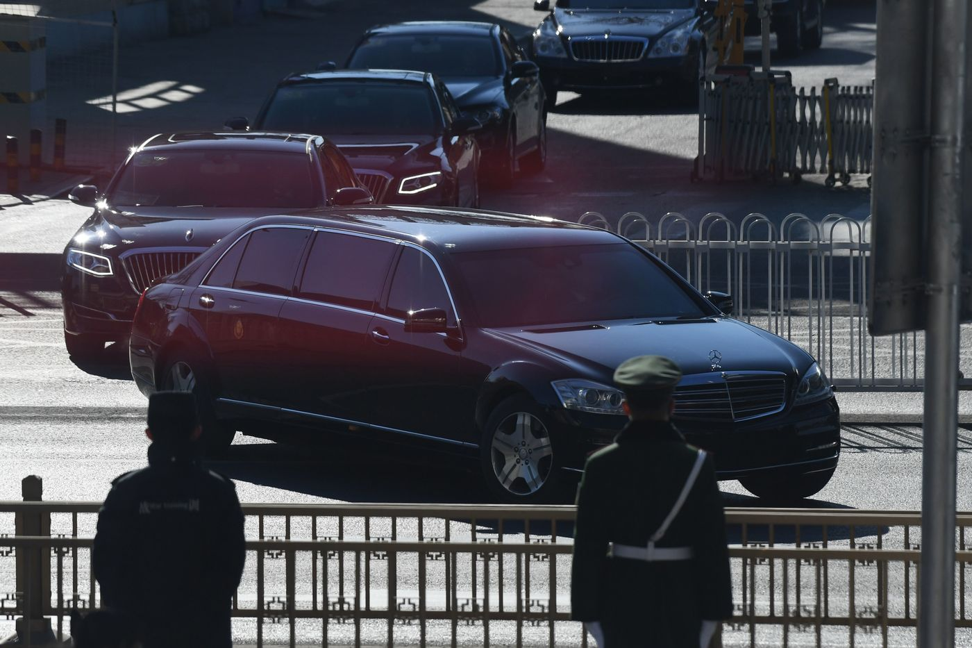 Cars in the motorcade of North Korean leader Kim Jong Un leave from Beijing Railway Station in Beijing on January 8, 2019. - North Korean leader Kim Jong Un arrived in Beijing on January 8 on an unannounced visit for talks with President Xi Jinping, as preparations ramp up for an expected second summit with Donald Trump. (Photo by GREG BAKER / AFP)