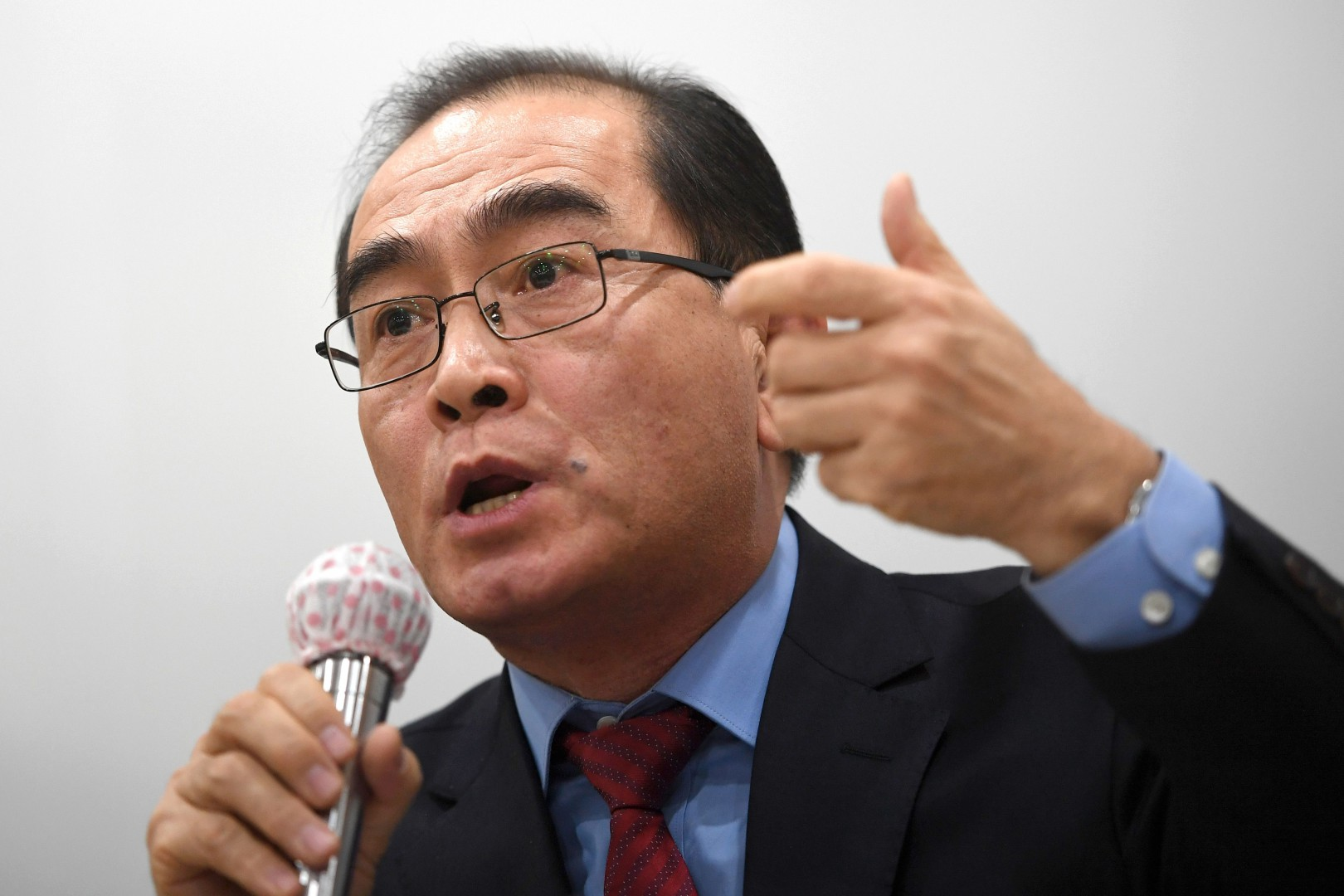 Thae Yong-ho, former North Korean deputy ambassador to Britain who defected to South Korea, speaks during a press conference to support Cho Seong Gil, a North Korean diplomat in Italy seeking asylum, in Seoul on January 9, 2019. - Jo Song Gil, the North's acting ambassador to Rome, went into hiding with his wife in November and is seeking asylum, according to Seoul's intelligence authorities. Thae, who said he once worked with Jo at Pyongyang's foreign ministry, wrote an open letter urging his ex-colleague to come to the South instead and work together to help the two Koreas reunify. (Photo by Jung Yeon-je / AFP)