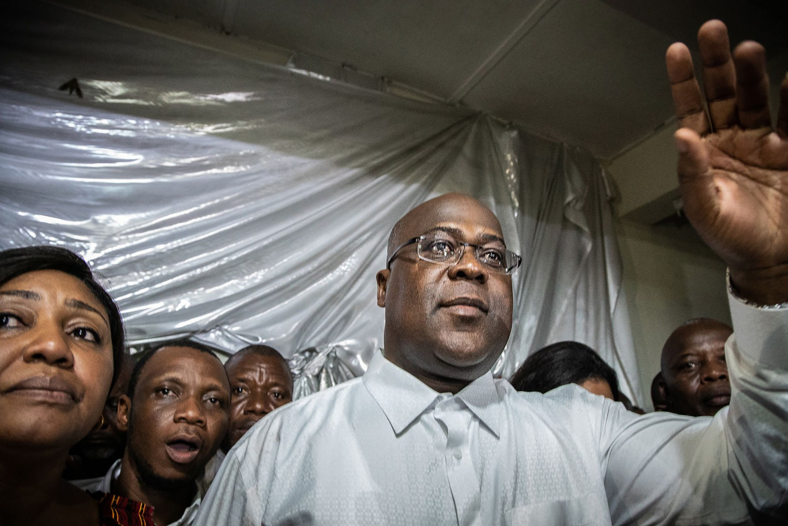 "Felix Tshisekedi gestures as he is surrounded by his wife, relatives and supporters of his UDPS party (Union for Democracy and Social Progress), a few minutes after he was declared winner of the presidential election following the announcement of the provisional results by the Independent National Electoral Commission (CENI), in his father's historic residence in Limete, Kinshasa on January 10, 2019. - France on January 10, 2019 challenged the outcome of DR Congo's presidential election, saying the declared victory of opposition chief Felix Tshisekedi was ""not consistent"" with the results and that his rival Martin Fayulu appeared to have won. (Photo by Caroline Thirion / AFP)"