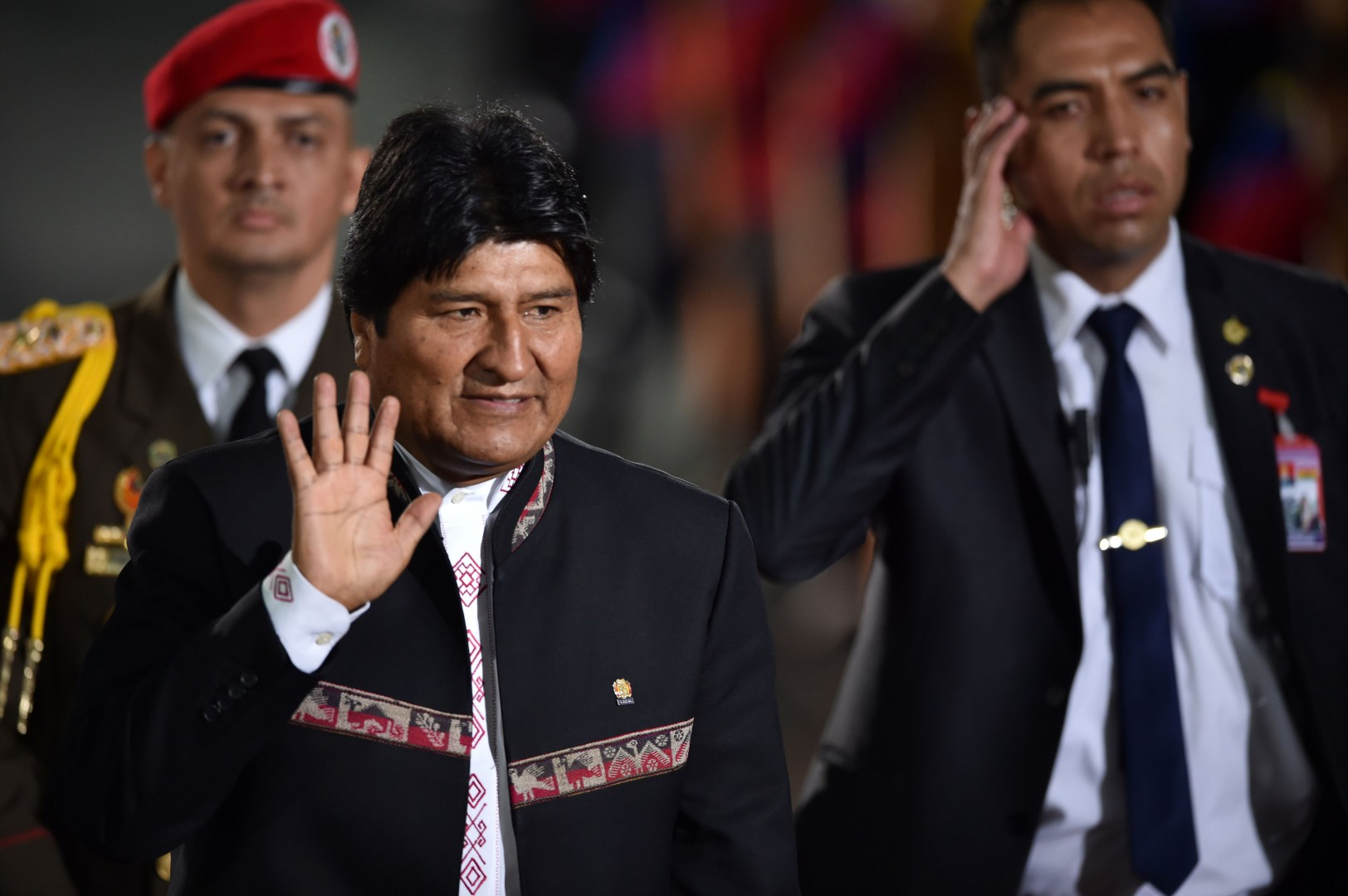 Bolivia's Presidenrt Evo Morales waves upon arrival for the inauguration ceremony of Venezuela's President Nicolas Maduro second mandate, at the Supreme Court of Justice (TSJ) in Caracas on January 10, 2019. - Maduro begins a new term that critics dismiss as illegitimate, with the economy in free fall and the country more isolated than ever. (Photo by YURI CORTEZ / AFP)