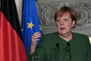 German Chancellor Angela Merkel gestures during a joint press conference with the Greek prime minister  in Athens on January 10, 2019. - German Chancellor Angela Merkel arrived in Greece amid tight security on January 10, 2019, as she looks to turn the page on the biting austerity measures that sparked major protests during her last official visit to Athens in 2014. (Photo by Louisa GOULIAMAKI / AFP)