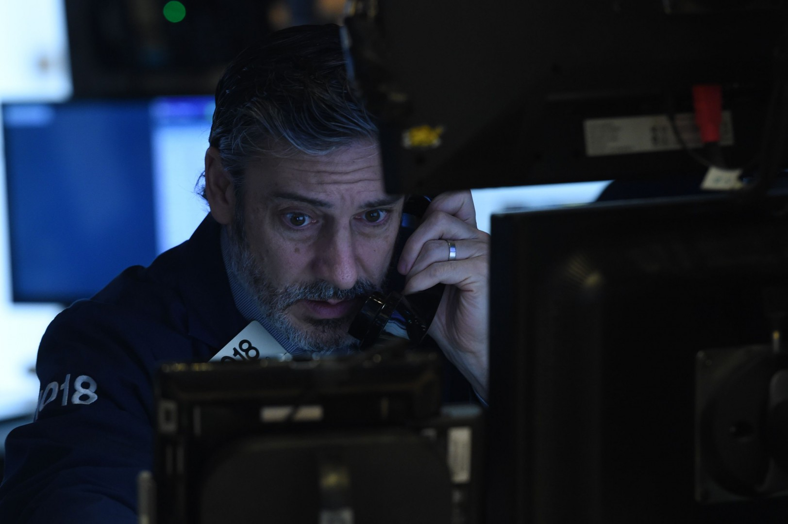 Traders work on the floor at the closing bell of the Dow Industrial Average at the New York Stock Exchange on January 10, 2019 in New York. - Wall Street stocks rose for a fifth straight session on Thursday, overcoming disappointing holiday sales from Macy's and other retailers following a day of choppy trade.The Dow Jones Industrial Average finished up 0.5 percent at 24,000.76.The broad-based S&P 500 also gained 0.5 percent to 2,596.59, while the tech-rich Nasdaq Composite Index advanced 0.4 percent to 6,986.07. (Photo by Bryan R. Smith / AFP)