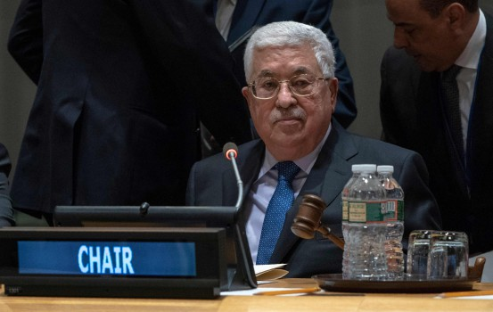 Palestinian president Mahmud Abbas taps the gavel to start a meeting of the United Nations Group of 77 and China January 15, 2019 at the United Nations in New York. - The event marked the state of Palestine taking over the chair of the G77 and China. (Photo by Don EMMERT / AFP)