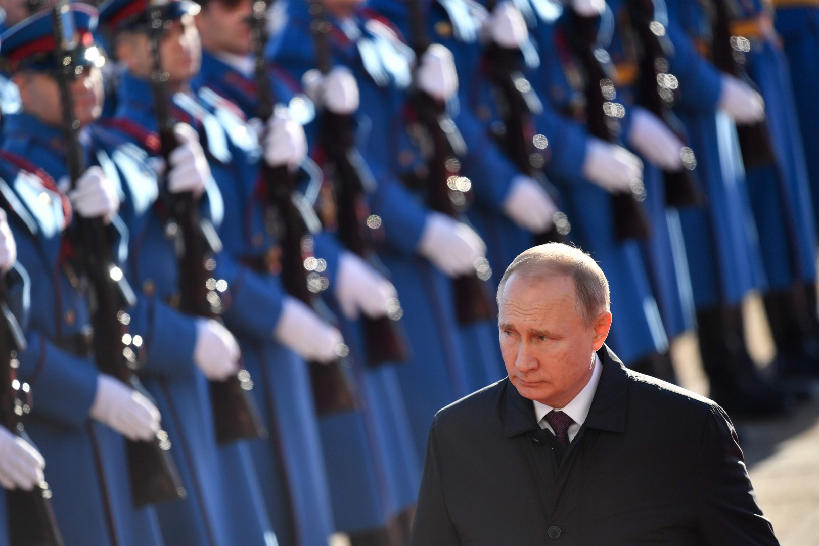 Russian President Vladimir Putin walks past Serbian honour guards during a welcoming ceremony at the Palace of Serbia on January 17, 2019, in Belgrade. (Photo by Andrej ISAKOVIC / AFP)