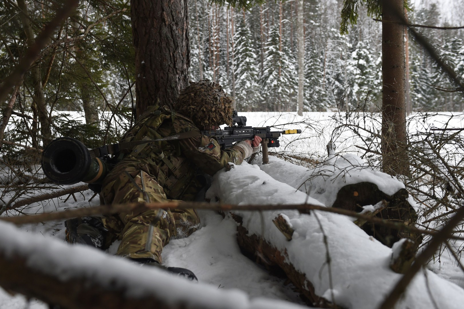 """A soldier from 1st Battalion The Royal Welsh fires blank rounds during """"Exercise Winter Camp"""" at a training area near Tapa in Estonia, where British troops are """"standing ready"""" to defend against a potentially aggressive Russia alongside Nato allies. LaPresse Only italy"""