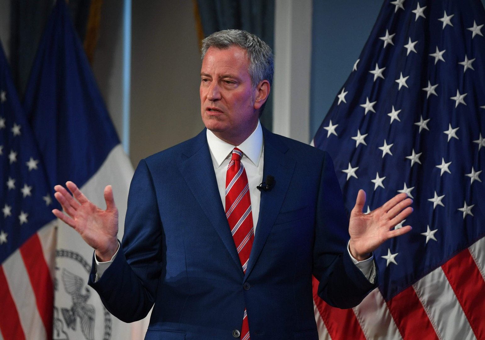 (FILES) In this file photo taken on April 26, 2017 New York City Mayor Bill de Blasio speaks as he presents the FY 2018 Executive Budget during a press conference at City Hall in New York. A nine-month-old baby, traumatized children, many with lice, bedbugs or contagious diseases: New York's mayor was shocked on June 20, 2018 that at least 239 minors arrived incognito after being separated from parents on the Mexican border. / AFP PHOTO / TIMOTHY A. CLARY