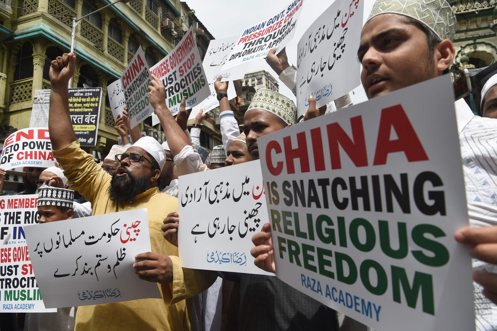 Indian Muslims hold placards during a protest against the Chinese government over the detention of Muslim minorities in Xinjiang, in Mumbai on September 14, 2018. - China has long imposed draconian restrictions on the lives of Muslim minorities in its Xinjiang region in the name of combating terrorism and separatism, with police measures intensifying in recent years. Upwards of one million ethnic Uighurs and other Turkic Muslim minorities are being held in counter-extremism centres, according to estimates cited by a United Nations panel on racial discrimination last month. (Photo by PUNIT PARANJPE / AFP)
