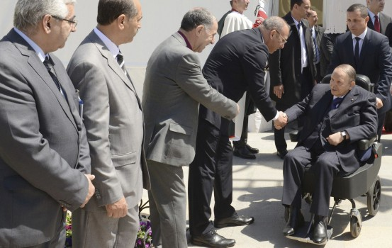"""In this file handout picture released by the official Algerian Press Service (APS), Algerian President Abdelaziz Bouteflika arrives for the inauguration of a mosque and the extension of the Algiers metro, in the capital Algiers, on April 9, 2018. - Algeria's frail President Abdelaziz Bouteflika, in power since 1999, will stand for a fifth term at elections next year, the head of his party said on October 28. National Liberation Front chief Djamel Ould Abbes said Bouteflika, who suffered a stroke in 2013, would be the party's candidate at the vote set for April 2019, state news agency APS reported. Bouteflika, 81, has yet to officially announce his candidacy. (Photo by Handout / various sources / AFP) / RESTRICTED TO EDITORIAL USE - MANDATORY CREDIT """"AFP PHOTO / APS"""" - NO MARKETING NO ADVERTISING CAMPAIGNS - DISTRIBUTED AS A SERVICE TO CLIENTS"""