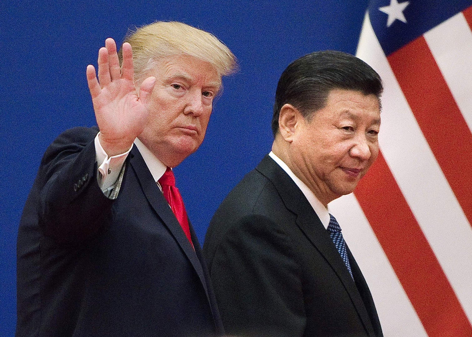 """(FILES) This file picture taken on November 9, 2017, shows US President Donald Trump (L) and China's President Xi Jinping leaving a business leaders event at the Great Hall of the People in Beijing. - Trump said on December 7, 2018, the negotiations to defuse the trade conflict with China are """"going very well."""" Trump met Xi during the G-20 summit in Buenos Aires and agreed to a 90-day tariff truce in order to find a more permanent solution to the costly dispute, but messages since have been mixed, roiling global stock markets. """"China talks are going very well!"""" Trump tweeted. (Photo by Nicolas ASFOURI / AFP)"""