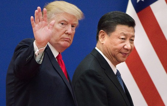 "(FILES) This file picture taken on November 9, 2017, shows US President Donald Trump (L) and China's President Xi Jinping leaving a business leaders event at the Great Hall of the People in Beijing. - Trump said on December 7, 2018, the negotiations to defuse the trade conflict with China are ""going very well."" Trump met Xi during the G-20 summit in Buenos Aires and agreed to a 90-day tariff truce in order to find a more permanent solution to the costly dispute, but messages since have been mixed, roiling global stock markets. ""China talks are going very well!"" Trump tweeted. (Photo by Nicolas ASFOURI / AFP)"