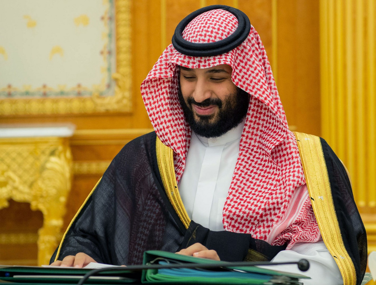 """A handout picture provided by the Saudi Press Agency (SPA) on December 18, 2018 shows Saudi Crown Prince Mohammed bin Salman attending the 2019 budget meeting in Riyadh. - Saudi Arabia announced its 2019 budget projecting a $35 billion shortfall, amounting to a deficit for the sixth year in a row due to low oil prices. (Photo by STRINGER / various sources / AFP) / === RESTRICTED TO EDITORIAL USE - MANDATORY CREDIT """"AFP PHOTO / HO / SPA"""" - NO MARKETING NO ADVERTISING CAMPAIGNS - DISTRIBUTED AS A SERVICE TO CLIENTS ==="""
