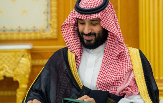 "A handout picture provided by the Saudi Press Agency (SPA) on December 18, 2018 shows Saudi Crown Prince Mohammed bin Salman attending the 2019 budget meeting in Riyadh. - Saudi Arabia announced its 2019 budget projecting a $35 billion shortfall, amounting to a deficit for the sixth year in a row due to low oil prices. (Photo by STRINGER / various sources / AFP) / === RESTRICTED TO EDITORIAL USE - MANDATORY CREDIT ""AFP PHOTO / HO / SPA"" - NO MARKETING NO ADVERTISING CAMPAIGNS - DISTRIBUTED AS A SERVICE TO CLIENTS ==="