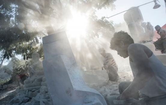 TOPSHOT - This photo taken on December 22, 2018 shows workers making Buddha statues in Sagyin village on the banks of the Ayeyerwady River in Madaya township, about 46 kms from Mandalay. - Sagyin village is known for producing marble statues, most of which are sold to Chinese traders, with the rest exported to Thailand, Vietnam and Taiwan. (Photo by YE AUNG THU / AFP)