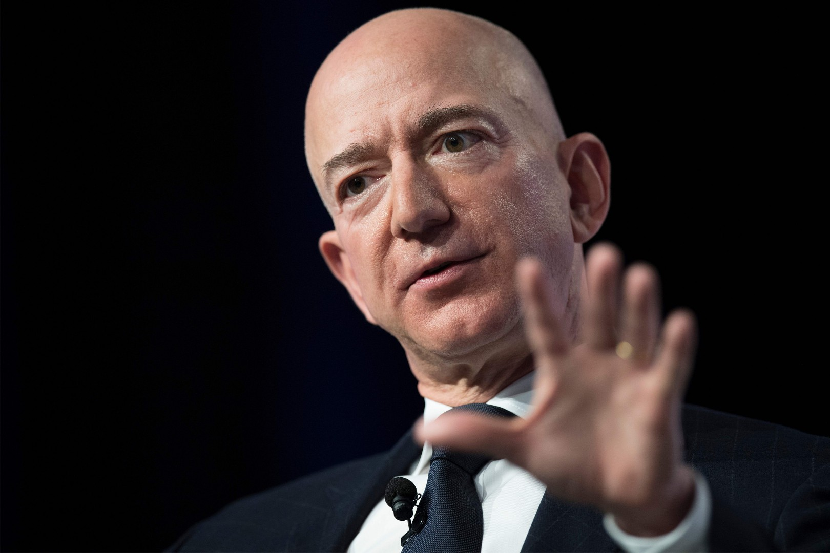 """(FILES) In this file photo taken on September 19, 2018 Amazon and Blue Origin founder Jeff Bezos provides the keynote address at the Air Force Association's Annual Air, Space & Cyber Conference in Oxen Hill, Maryland. - Amazon founder Jeff Bezos, rated the world's wealthiest person, announced on January 9, 2019 on Twitter that he and his wife Mackenzie Bezos were divorcing after a long separation. """"We want to make people aware of a development in our lives,"""" Jeff Bezos, 54, and MacKenzie Bezos, 48, said in joint statement posted to Bezos' Twitter feed. (Photo by Jim WATSON / AFP)"""