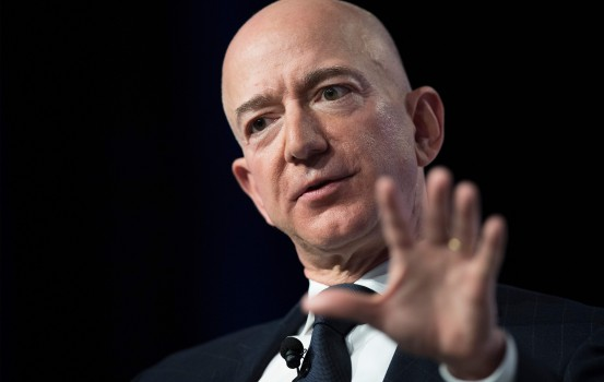 "(FILES) In this file photo taken on September 19, 2018 Amazon and Blue Origin founder Jeff Bezos provides the keynote address at the Air Force Association's Annual Air, Space & Cyber Conference in Oxen Hill, Maryland. - Amazon founder Jeff Bezos, rated the world's wealthiest person, announced on January 9, 2019 on Twitter that he and his wife Mackenzie Bezos were divorcing after a long separation. ""We want to make people aware of a development in our lives,"" Jeff Bezos, 54, and MacKenzie Bezos, 48, said in joint statement posted to Bezos' Twitter feed. (Photo by Jim WATSON / AFP)"