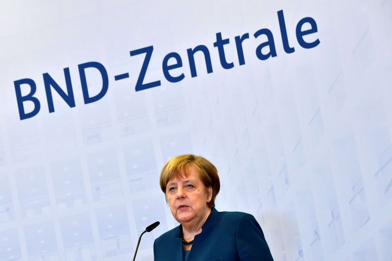 German Chancellor Angela Merkel gives a speech during the official opening ceremony of the Federal Intelligence Service (BND) building on February 8, 2019 in Berlin. (Photo by John MACDOUGALL / AFP)