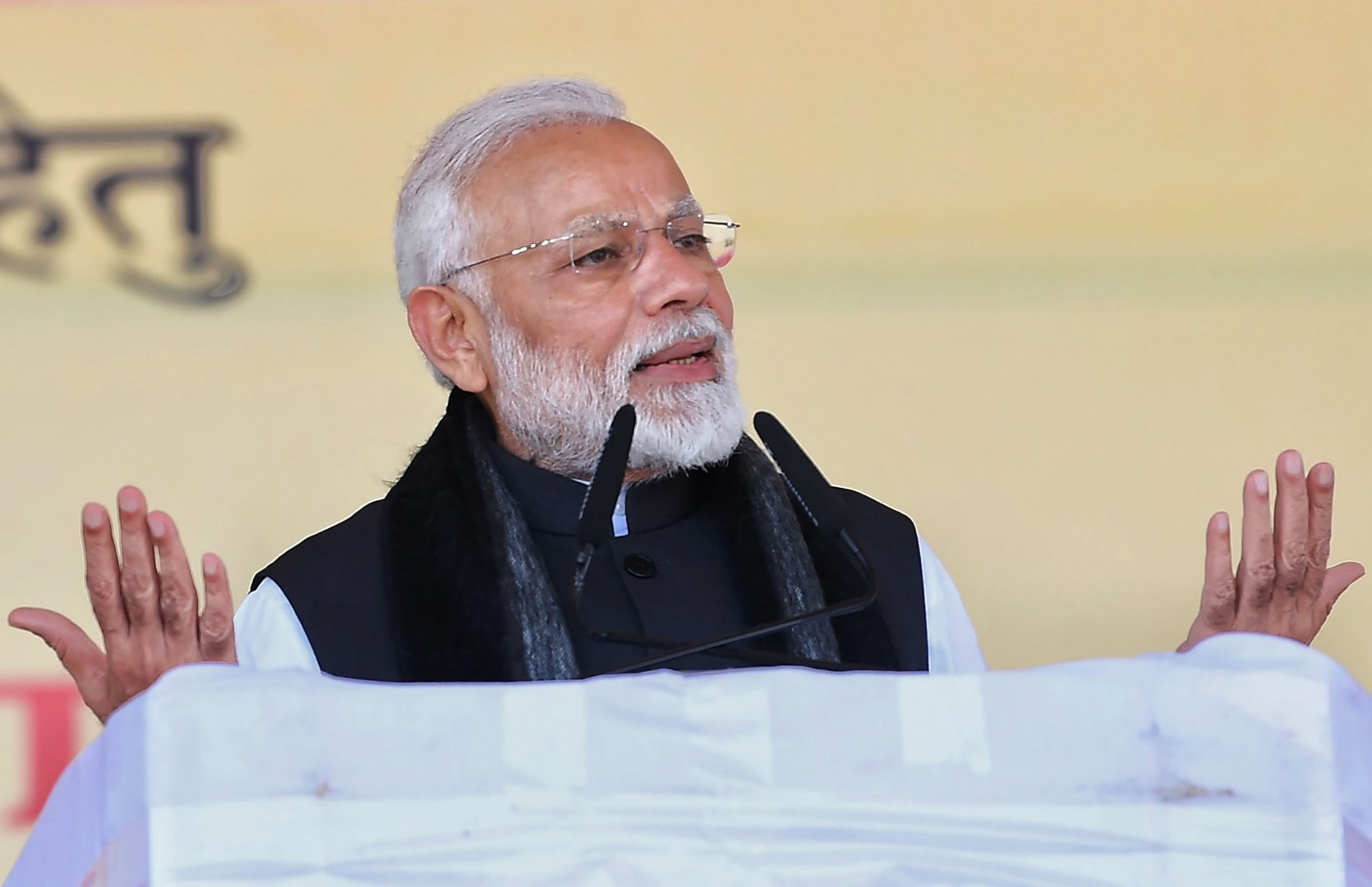 """This handout photograph released by India's Press Information Bureau (PIB) on February 15, 2019 shows Indian Prime Minister Narendra Modi speaking during the inauguration and foundation stone laying ceremony of various development projects in Jhansi, in the Indian state of Uttar Pradesh. (Photo by Handout / AFP) / RESTRICTED TO EDITORIAL USE - MANDATORY CREDIT """"AFP PHOTO / PIB"""" - NO MARKETING NO ADVERTISING CAMPAIGNS - DISTRIBUTED AS A SERVICE TO CLIENTS ---"""