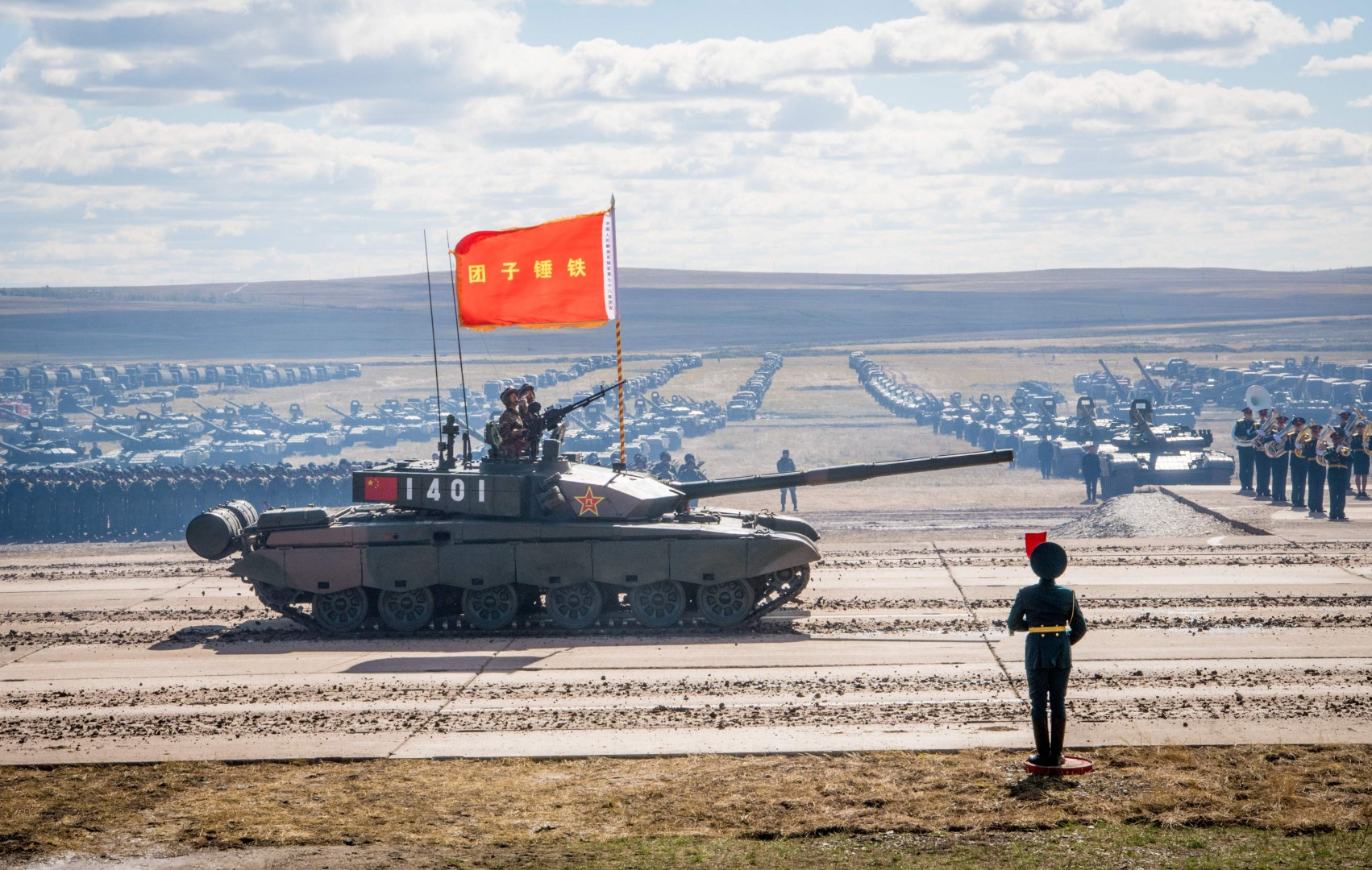 TOPSHOT - Russian, Chinese and Mongolian troops and military equipment parade at the end of the day of the Vostok-2018 (East-2018) military drills at Tsugol training ground not far from the Chinese and Mongolian border in Siberia, on September 13, 2018. (Photo by MLADEN ANTONOV / AFP)