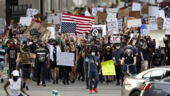 Protesters march after a rally in Detroit on Wednesday, June 3, 2020, over the death of George Floyd, a black man who died after being restrained by Minneapolis police officers on May 25 (AP Photo/Paul Sancya)