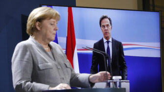 German Chancellor Angela Merkel listens to Netherlands Prime Minister Mark Rutte during a virtual news conference