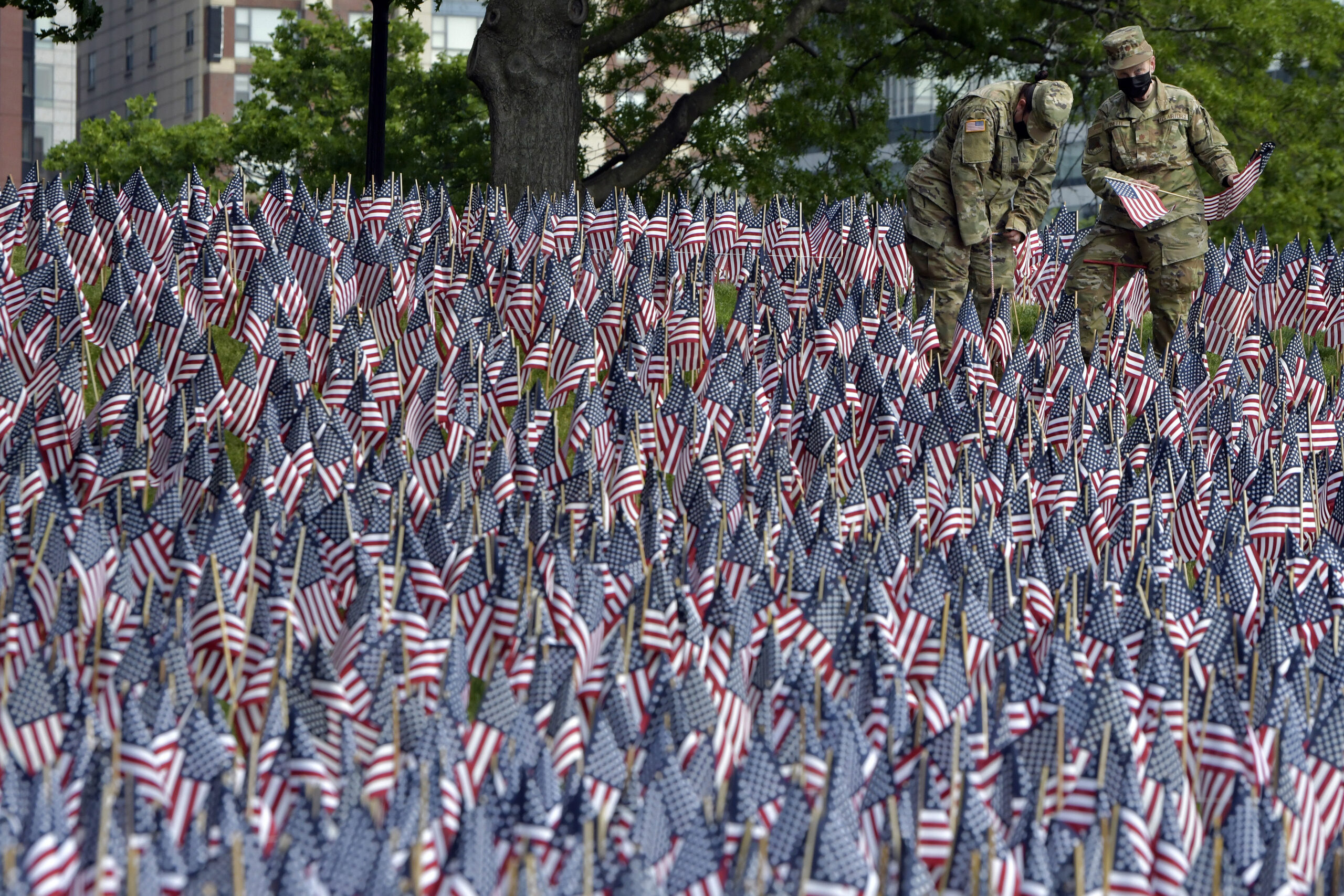Air National Guard were among those planting American flags on Boston Common Wednesday, May 26, 2021